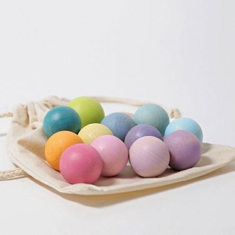 12 Boles de fusta massisses de colors pastel en bossa de cotó