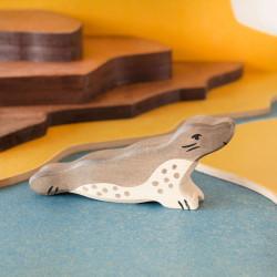 Foca con cabeza alzada - animal de madera